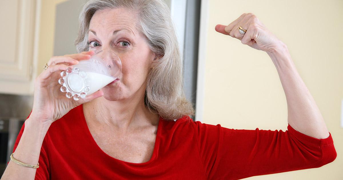 Older woman drinking glass of milk
