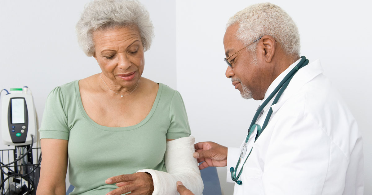 Woman having broken arm checked out by doctor