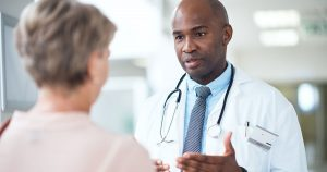 Doctor speaking with older woman