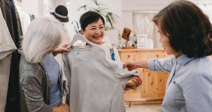 Three older woman shopping for clothing together