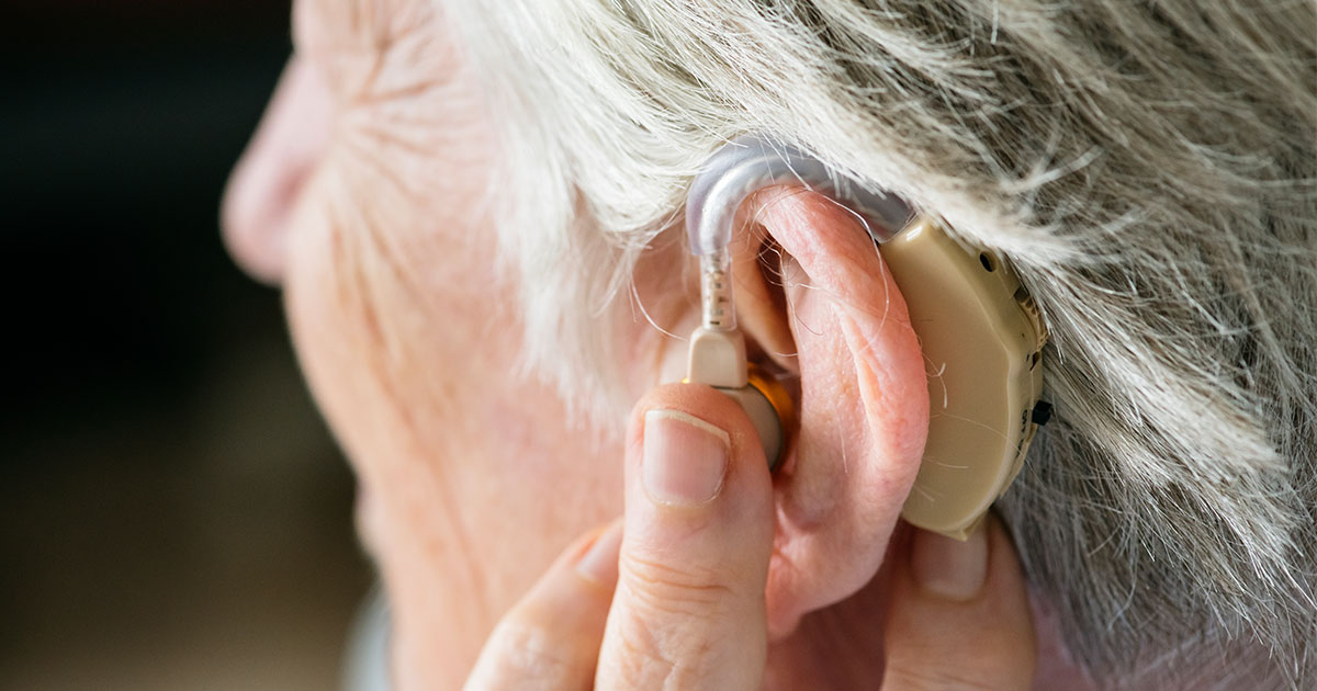 Older woman with hearing aid in ear