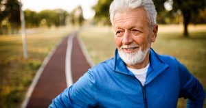 Older man on a running track outside