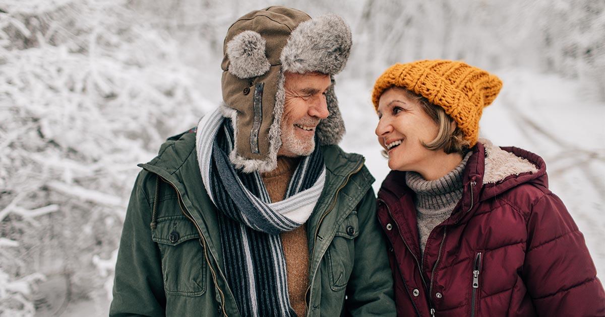 Older man and woman walking outside in wintertime