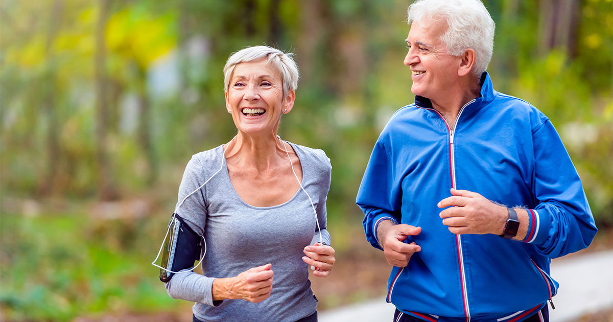 Older man and woman jogging