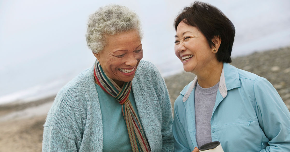 Two older women outside, laughing