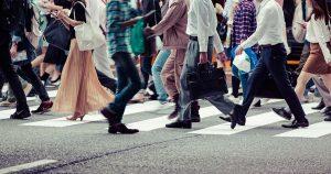 Crowd of people walking on crosswalk
