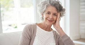 Older woman with cheek resting on hand