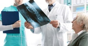 a woman receiving an osteoporosis diagnosis
