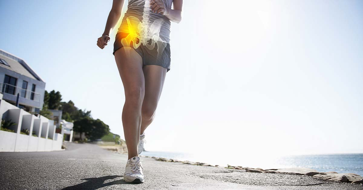 Someone running with their hip bone glowing in yellow to show where the hip bone is in the human body.